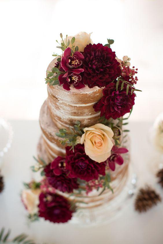 naked fall wedding cake with burgundry flowers