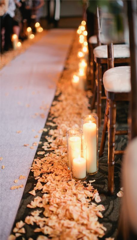 romantic candle-decorated fall wedding aisle