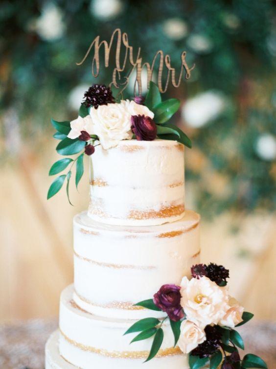 semi-naked fall wedding cake with burgundy flowers