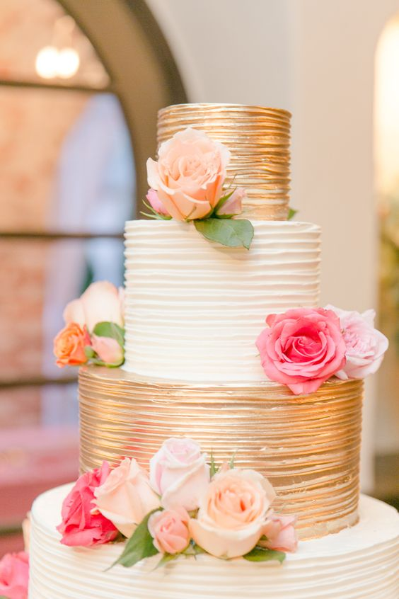 shiny gold and white wedding cake idea