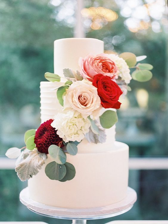 simple wedding cake with fall flowers