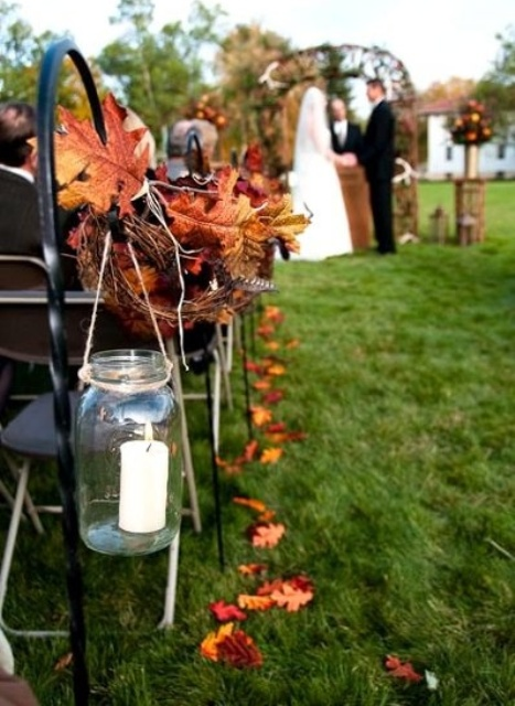 stunning fall wedding aisle decoration with maple leaves