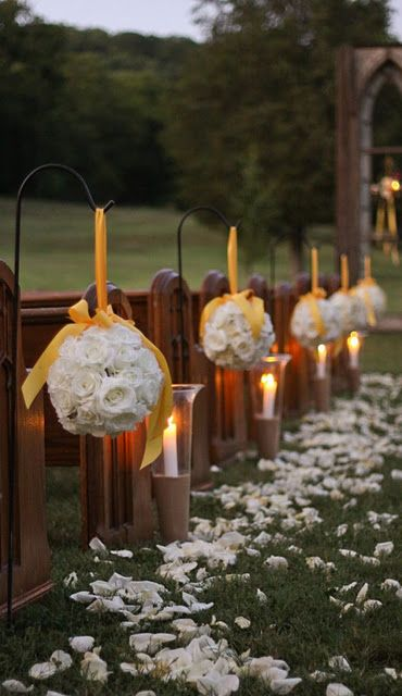 yellow and white floral wedding aisle decoration