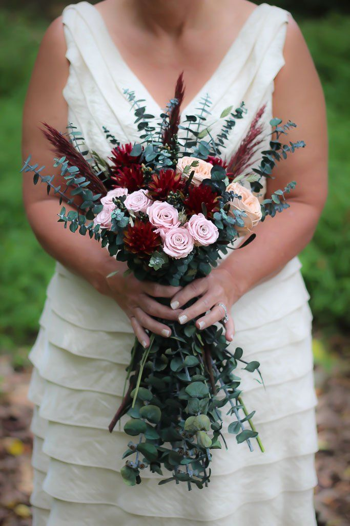 Dahlias garden import white roses burgundy red roses coffee bean in a nosegay for a bridal bouquet
