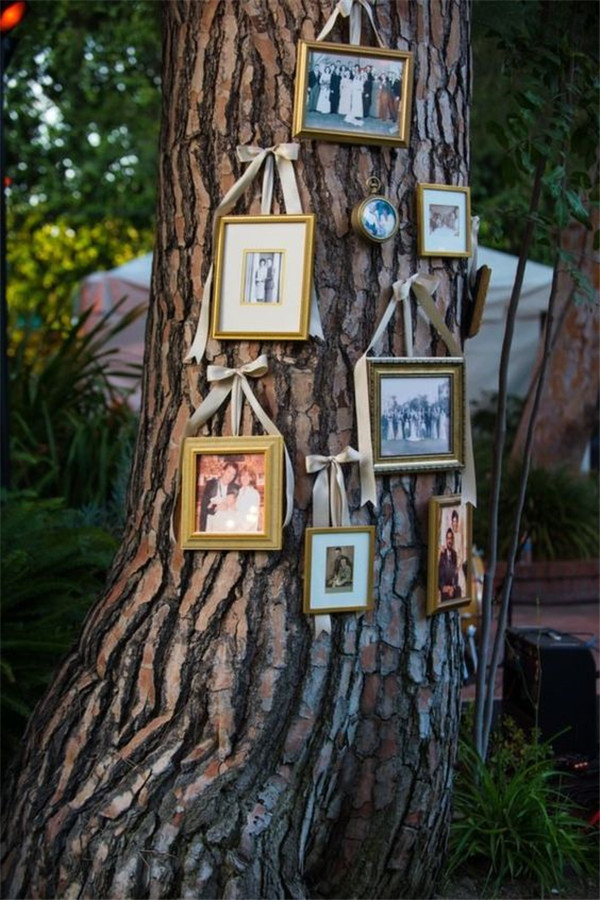 Gallery wall on a tree for backyard wedding by Inspired by This