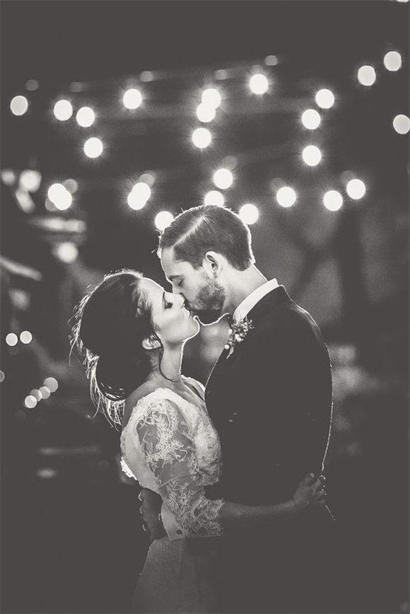 Bride and groom photo under festoon lights | Angela Rose Photography