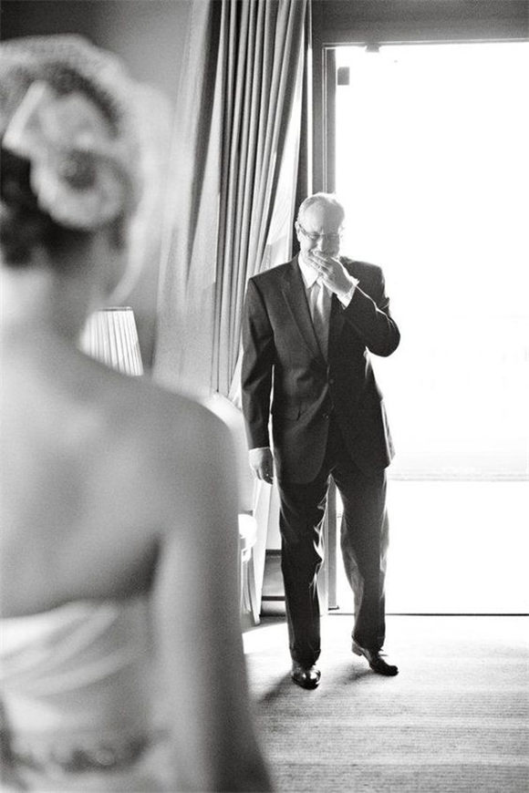 Such a sweet picture- dads reaction to you in your wedding dress on the big day!