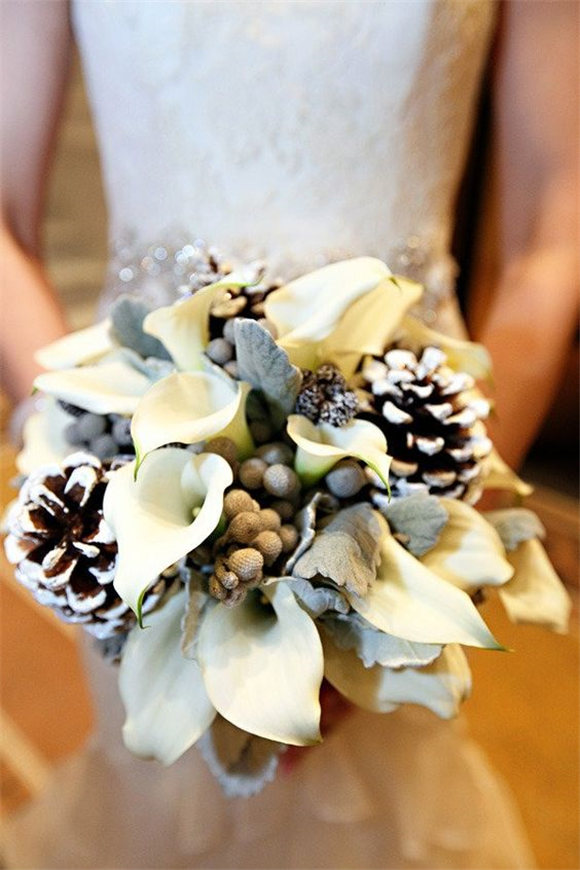 Winter wedding bouquet - love the idea of incorporating pinecones!