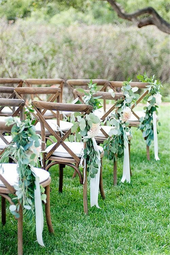 I love the idea of tying loose eucalyptus on the chairs along the aisle