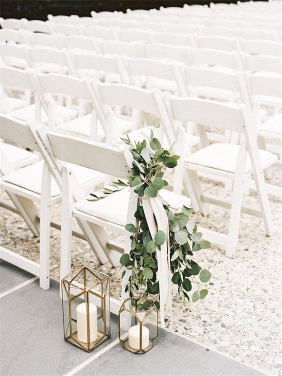 Lantern aisle decor, greenery