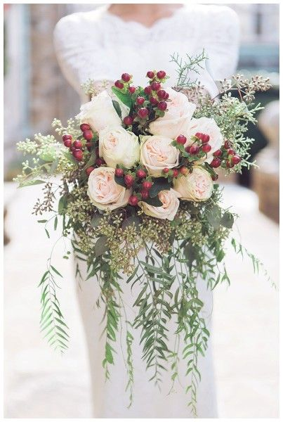 Holiday bouquet in green pink red for christmas wedding